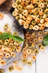 Making fresh rainbow italian tortellini with organic produce.