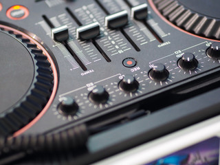 Modern DJ station gear close-up, mixer, with controllers and spinners, control audio panel equipment