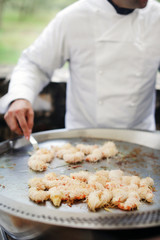Shrimp scampi grilled on tepan grill, wrapped in noodles, chef