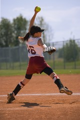 Girl Winding Up To Pitch