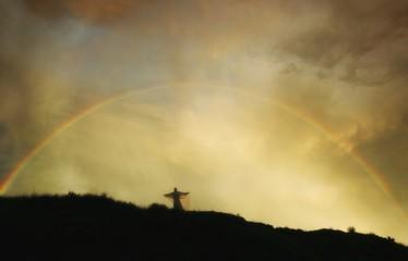 Rainbow Over Angel On Hill