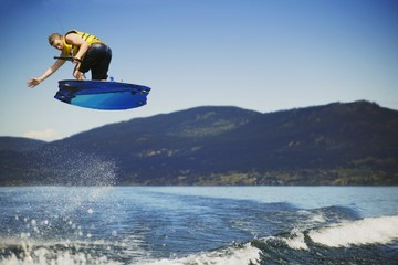 A Wakeboarder jumping over sea