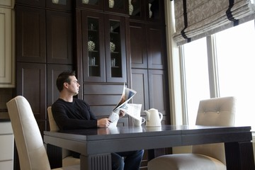Man Reading The Newspaper At Home