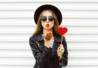 Fashion pretty sweet young woman with red lips sends air kiss wi