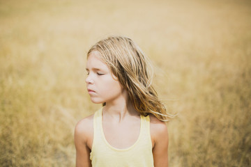 Portrait of a girl in a golden field; Peachland, British Columbia, Canada