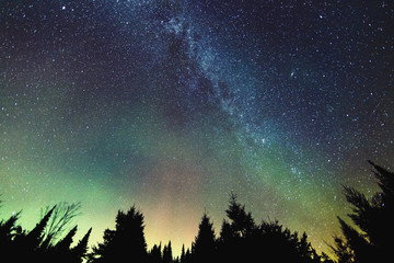 Aurora Borealis and milky way visible in the sky, Mont-Tremblant National Park; Lanaudiere region, Quebec, Canada