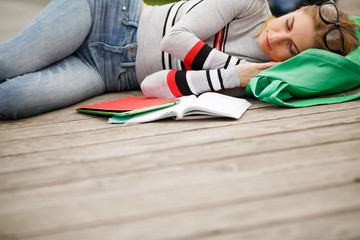 Sleeping student with Tablet and notebooks
