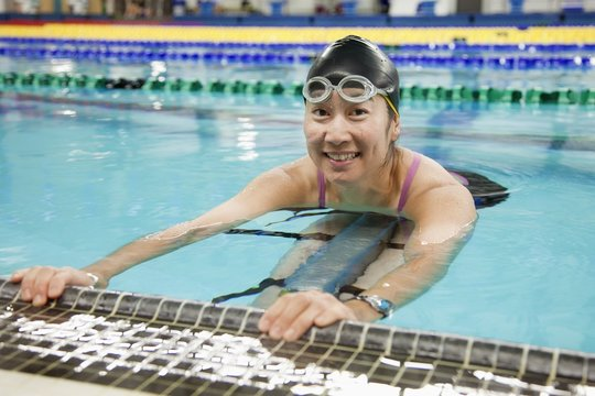 A Paraplegic Woman Swims In A Pool; Edmonton, Alberta, Canada