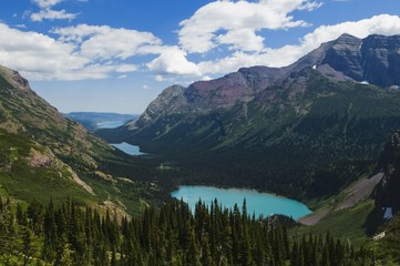 Montana, United States Of America; Grinnell, Lake Josephine, And Swiftcurrent Lake (Foreground To Background) Viewed From The Grinnell Glacier Trail In Glacier National Park