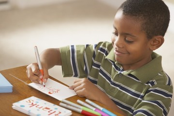 A Boy Writing Thank You Cards