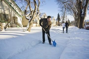 Man Shovelling Sidewalk