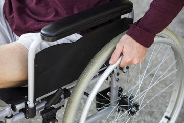 closeup of man sitting in wheel chair
