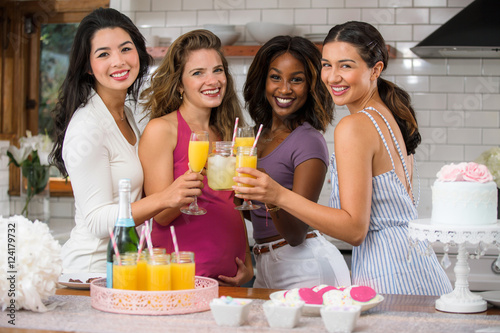 ladies wine party group of ladies friends cheers toast wine mimosas at a baby shower