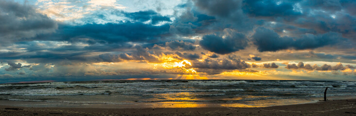 Cloudy sunset at beach