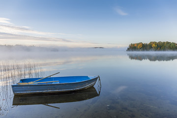 Rowboat on a Misty Lake in Autumn - Ontario, Canada