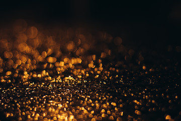Orange Drops with blur bokeh on a dark background