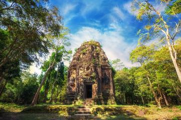 Ancient Khmer pre Angkor architecture. Sambor Prei Kuk temple ruins with giant banyan trees under blue sky. Kampong Thom, Cambodia travel destinations Wall mural