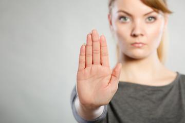 Assertive woman making stop gesture.