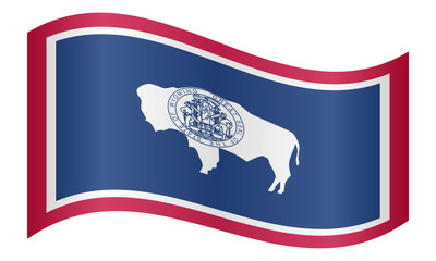 Flag of Wyoming waving on white background