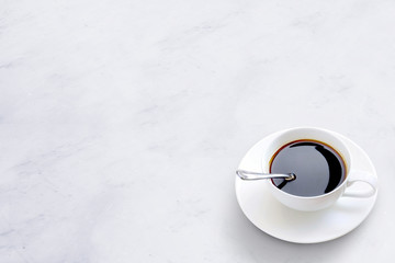 Cup of Coffee on Marble Table Background.
