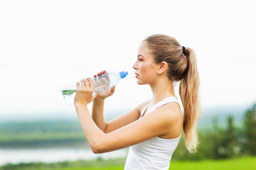 Young woman with a bottle of water