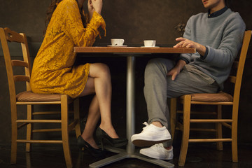 Young couple drinking coffee in a cafe