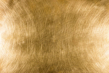 scratched industrial brass metal plate textured background pattern with light reflections Wall mural