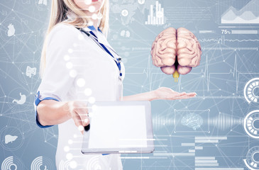 Double Exposure, Doctor holding human organs ( brain) and tablet , gray background.