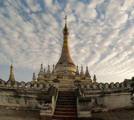 Stupa near Maha Aungmye Bonzan temple at sunset, Ava, Myanmar