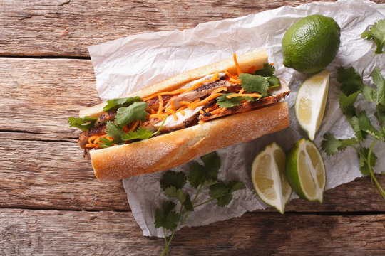 Vietnamese Pork Banh Mi Sandwich with Cilantro and carrot close-up. horizontal top view