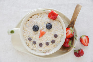 Snowman porridge oatmeal breakfast , Fun Christmas food art for