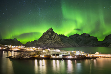 Aurora borealis over a village on the Lofoten in Norway