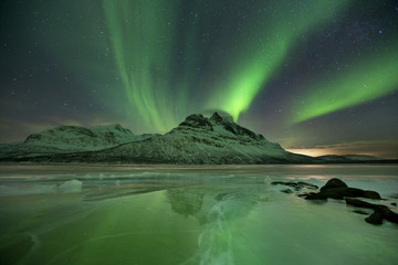 Aurora borealis over a frozen lake in northern Norway