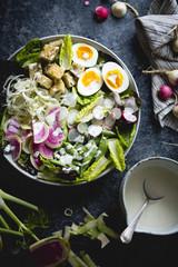 Spring greens salad with fennel, radish & miso-buttermilk dressi