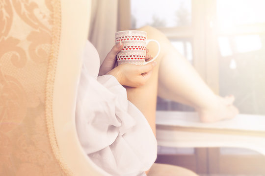 woman sipping coffee in a magic moment of quiet