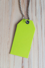 Blank label (tag) on wooded background. Price tag, gift tag
