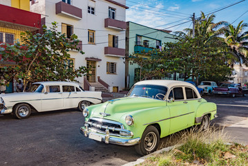 green vintage car in havana, cuba
