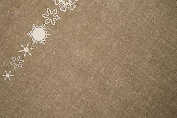 Рождество текстура. Белые снежинки льняная ткань. Зима открытка