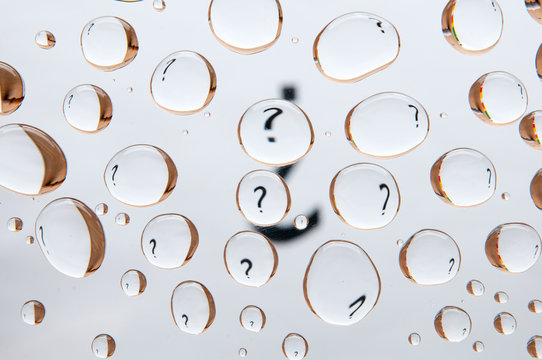 Question mark behind water drops. Abstract background