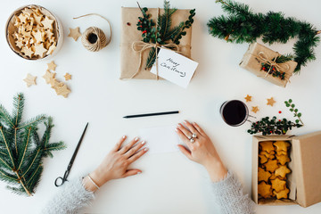 Woman holding blank paper for writing Christmas card