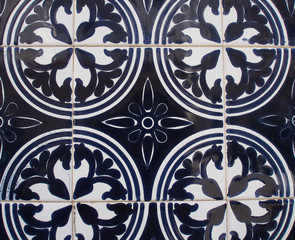 Detail of the traditional tiles from facade of old house. Decorative tiles