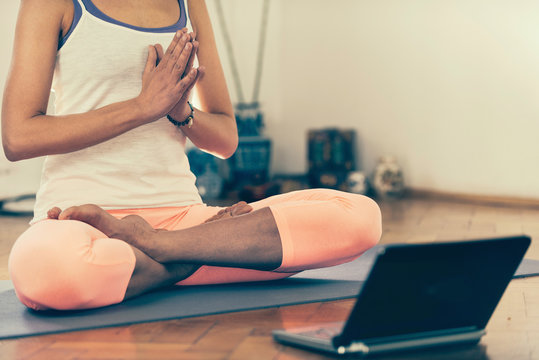 Doing Yoga at home with virtual instructor