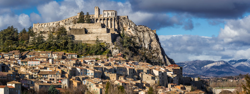Sisteron rooftops with its Citadel and fortifications (panoramic). Alpes de Haute Provence, Southern Alps, France