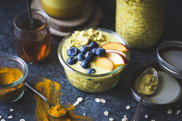 Healthy Golden milk overnight oats for breakfast with fresh frui