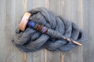 Drop spindle with yarn made of sheep wool