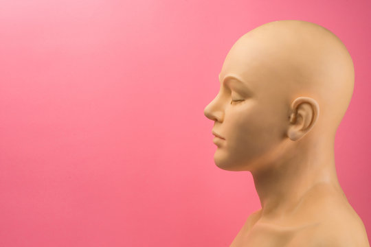 A mannequin against a pink background highlighting cancer awareness