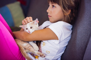 beautiful little girl with a nice white cat