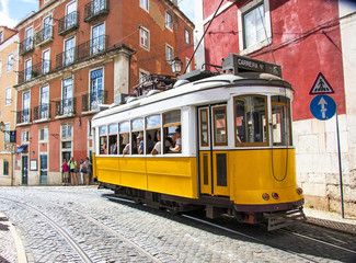 Famous old yellow tram on street of Lisbon/Lisboa.