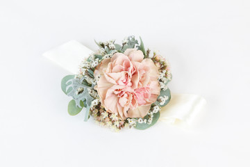 Dusty pink carnation wrist corsage isolated on white background