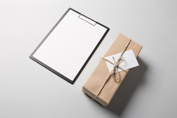 lipboard with blank paper and package.